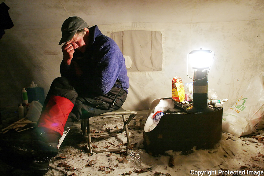 HALFWAY POINT... William Kleedehn rests in his tent in Dawson City on Thursday. Kleedehn was the second musher to arrive into the Klondike town.