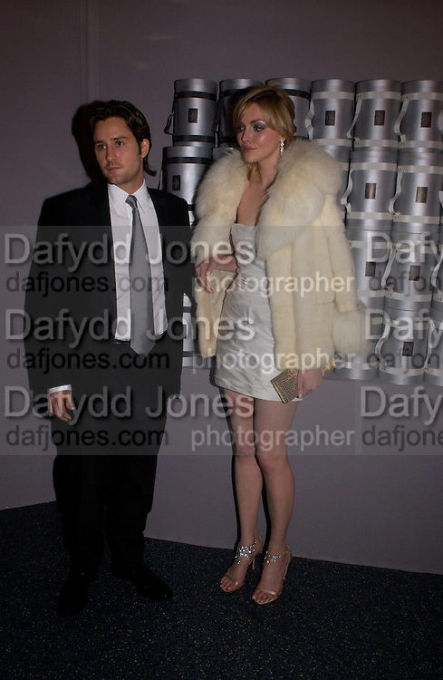 Sophie Dahl and Dan Baker, Party to celebrate 100 years of the Santos  de Cartier watch. Le Bourget airport. Paris. 7 April 2004. ONE TIME USE ONLY - DO NOT ARCHIVE  © Copyright Photograph by Dafydd Jones 66 Stockwell Park Rd. London SW9 0DA Tel 020 7733 0108 www.dafjones.com