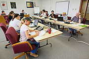 """03 JUNE 2011 - SPRINGERVILLE, AZ: Volunteers man phones in the fire information office in Round Valley Primary school. High winds and temperatures have continued to complicate firefighters' efforts to get the Wallow fire under control. The  mandatory evacuation order for Alpine was extended to Nutrioso, about 10 miles north of Alpine and early Friday morning fire was reported on the south side of Nutrioso. The fire grew to more than 106,000 acres early Friday with zero containment. A """"Type I"""" incident command team has been called in to manage the fire.   PHOTO BY JACK KURTZ"""