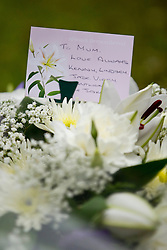 © Licensed to London News Pictures . 30/08/2012 . Manchester, UK . Flowers and tributes left during the funeral of Winniw Johnson at St Chrysostom's Church, Victoria Park in Manchester on August 30, 2012. Winnie Johnson devoted her life to finding the body of her 12 year old son Keith Bennett who was murdered by Moors Murderer Ian Brady and Myra Hindley. Photo credit : Joel Goodman/LNP