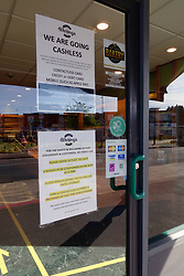 Coronavirus warning sign on bakery door during Coronavirus lockdown, Reading UK May 2020
