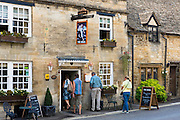 Tourist couples at The Royal Oak inn traditional old gastro pub hotel in Burford in The Cotswolds, Oxfordshire, UK
