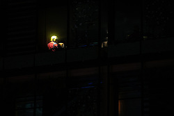 © Licensed to London News Pictures . 04/01/2019 . Manchester , UK . A firefighter is seen through an upstairs window of the Ivy Restaurant in Manchester City Centre . Firefighters attend a fire at the Ivy Restaurant and bar lounge in Spinningfields in Manchester . Photo credit : Joel Goodman/LNP
