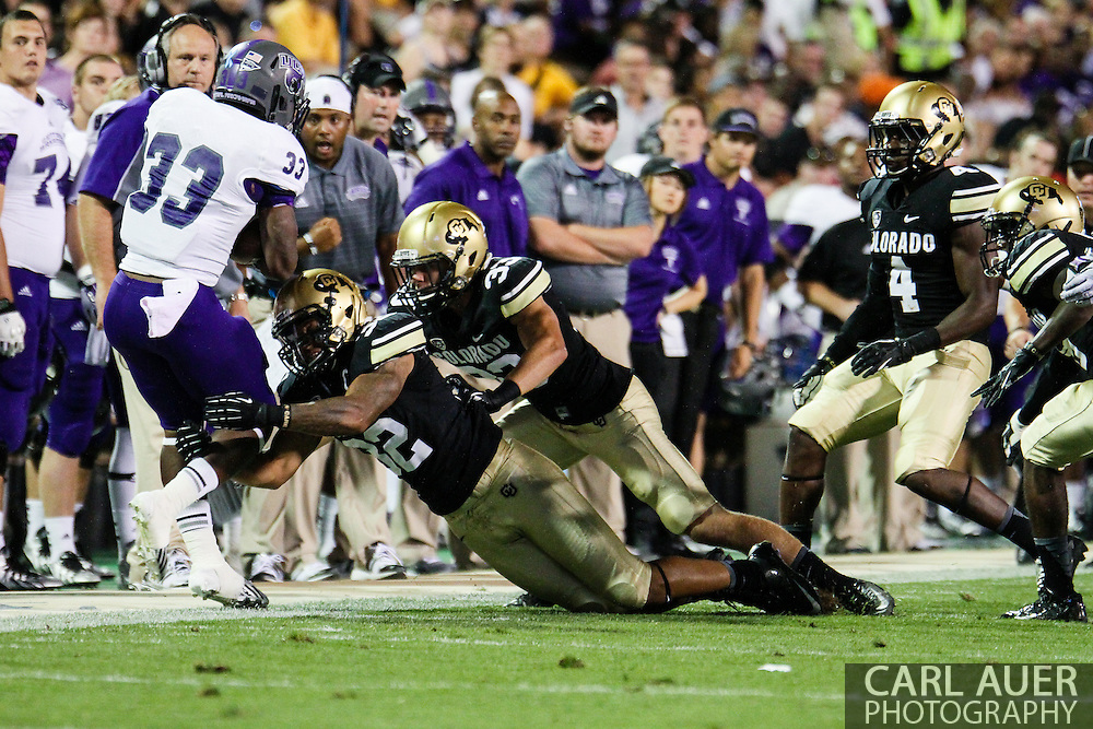 September 7th, 2013 - University of Central Arkansas Bears sophomore running back Danzel Williams (33) is pushed out of bounds by Colorado Buffaloes senior outside linebacker Paul Vigo (32) and sophomore defensive back Richard Yates II (33) in the second half of action in the NCAA football game between the University of Central Arkansas Bears and the University of Colorado Buffaloes at Folsom Field in Boulder, CO
