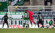 27th August 2017, Dens Park, Dundee, Dundee; Scottish Premier League football, Dundee versus Hibernian; Dundee goalkeeper Scott Bain punches clear