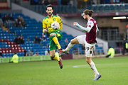 Burnley forward Jay Rodriguez (19) challenged by the opponent during the The FA Cup match between Burnley and Norwich City at Turf Moor, Burnley, England on 25 January 2020.