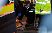 A protester goes under a police van in protest bank outside the bank of iraq.. Occupy London had taken over  7-10 Ledenhall st in London on January 27th 2012..Incident Commander confirmed theres a chemical leek in the building...Photo Ki Price .