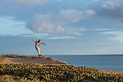 Mike Misselwitz rides his Onewheel powered skateboard at the cliffs south of Carlsbad, CA.