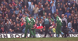 COVENTRY, ENGLAND - Saturday, April 6, 1996: Liverpool's Steve Harkness is carried off on a stretcher after having his leg broken by a reckless tackle from Coventry City's John Salako during the Premiership match at Highfield Road. Coventry won 1-0. (Pic by David Rawcliffe/Propaganda)