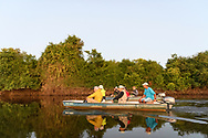 Tourists in a boat on the Rio Negro, Pantanal, Mato Grosso do Sul, Brazil