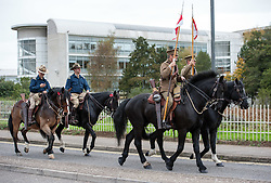 © Licensed to London News Pictures. 23/10/2015. Bristol, UK. Enactment Lancers pass MOD Abbeywood. Enactment Lancers in World War One uniform on horseback parade through Bristol to launch the Bristol Poppy Appeal organised by the Royal British Legion. Relatives of Bristol Poppy seller Olive Cooke at an event outside Bristol Cathedral, organised by the Royal British Legion, received a ceramic poppy in memory of Olive from the Blood Swept Lands and Seas of Red exhibition. Photo credit : Simon Chapman/LNP