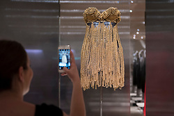 "© Licensed to London News Pictures. 09/05/2018. LONDON, UK.  A visitor takes a photo at the preview of ""Azzedine Alaïa:  The Couturier"", the first UK exhibition of Azzedine Alaïa examining the work of one of the most respected fashion designers in history.  Over 60 rare and iconic garments are on display alongside a series of specially commissioned pieces.  The exhibition runs 10 May to 7 October 2018 at the Design Museum.  Photo credit: Stephen Chung/LNP"