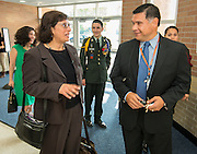 Sonia Nazario, left, talks with Rene Sanchez, right, before her presentation to students at Chavez High School, September 26, 2014.