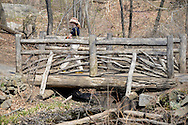Small Wooden Bridge with woman in Central Park, Manhattan.