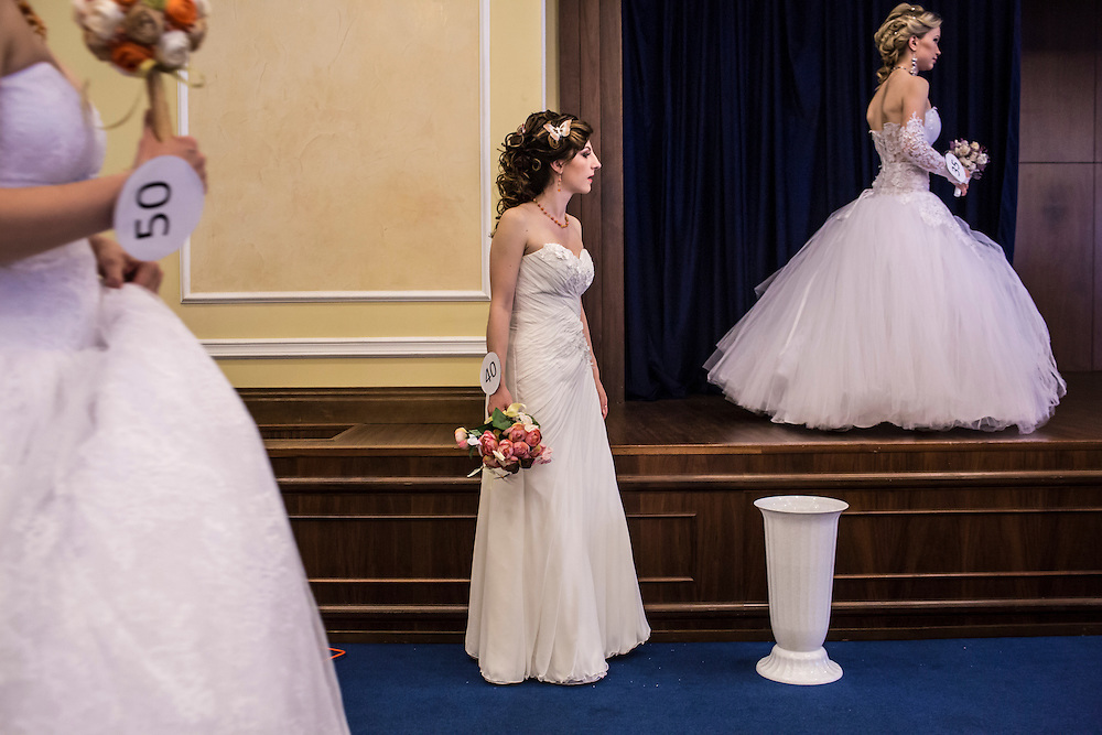 DONETSK, UKRAINE - MAY 18: Contestants at a bridal contest stand in the wings as other contestants are photographed on May 18, 2014 in Donetsk, Ukraine. A week before presidential elections are scheduled, questions remain whether the eastern regions of Donetsk and Luhansk are stable enough to administer the vote. (Photo by Brendan Hoffman/Getty Images) *** Local Caption ***