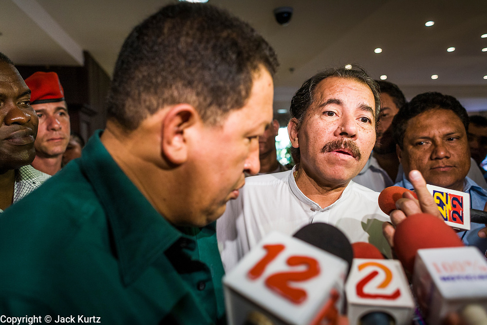 12 JANUARY 2007 - MANAGUA, NICARAGUA: HUGO CHAVEZ, President of Venezuela (left) and DANIEL ORTEGA, President of Nicaragua talk to reporters in Managua before Chavez left Nicaragua to return to Venezuela. Chavez has promised massive amounts of aid  for Nicaragua including free and discounted oil and portable electric generating stations. Nicaragua is the second poorest country in the western hemisphere.  Photo by Jack Kurtz / ZUMA Press