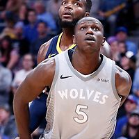 05 April 2018: Minnesota Timberwolves center Gorgui Dieng (5) vies for the rebound with Denver Nuggets forward Paul Millsap (4) during the Denver Nuggets 100-96 victory over the Minnesota Timberwolves, at the Pepsi Center, Denver, Colorado, USA.