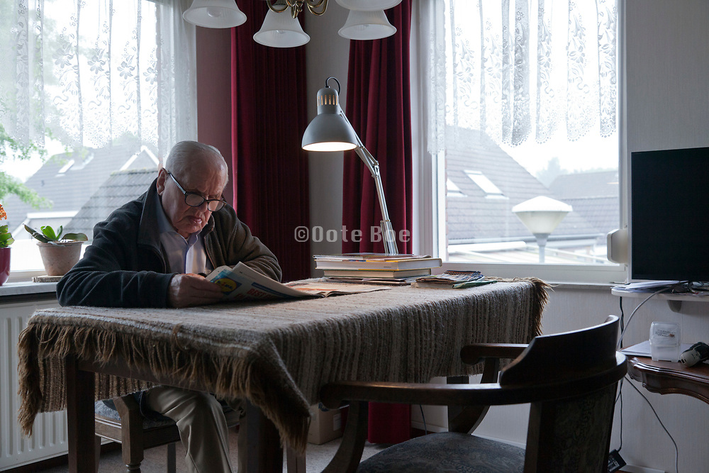 senior over 90 years old man reading the newspaper