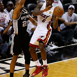 Jun 6, 2013; Miami, FL, USA; Miami Heat small forward LeBron James (6) passes the ball defended by San Antonio Spurs power forward Tim Duncan (21) in the first quarter during game one of the 2013 NBA Finals at the American Airlines Arena. Mandatory Credit: Derick E. Hingle-USA TODAY Sports