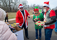 From left, Steve Willans, Debbie Kaelin of Bensalem, and Gary Gifford of Bensalem hand out gifts as other members of the Delaware Valley Iron Indian Riders Association held their annual Ride Of the Santas and dropped off toys to children at  Saturday, December 21, 2019 at St Francis-St Vincent Home For Children in Bensalem, Pennsylvania. (Photo by William Thomas Cain / CAIN IMAGES)