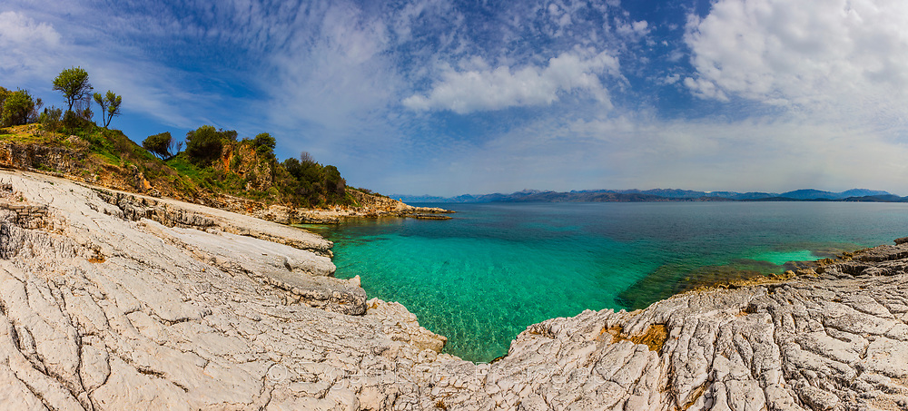 Ionian beach with wite rocks and turquoise water