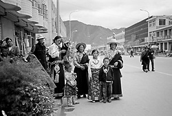 China, Xiahe, 2005. Relatives wait outside for the bride and groom to arrive. Participants were welcomed to a traditional Tibetan ceremony and a Chinese dinner..