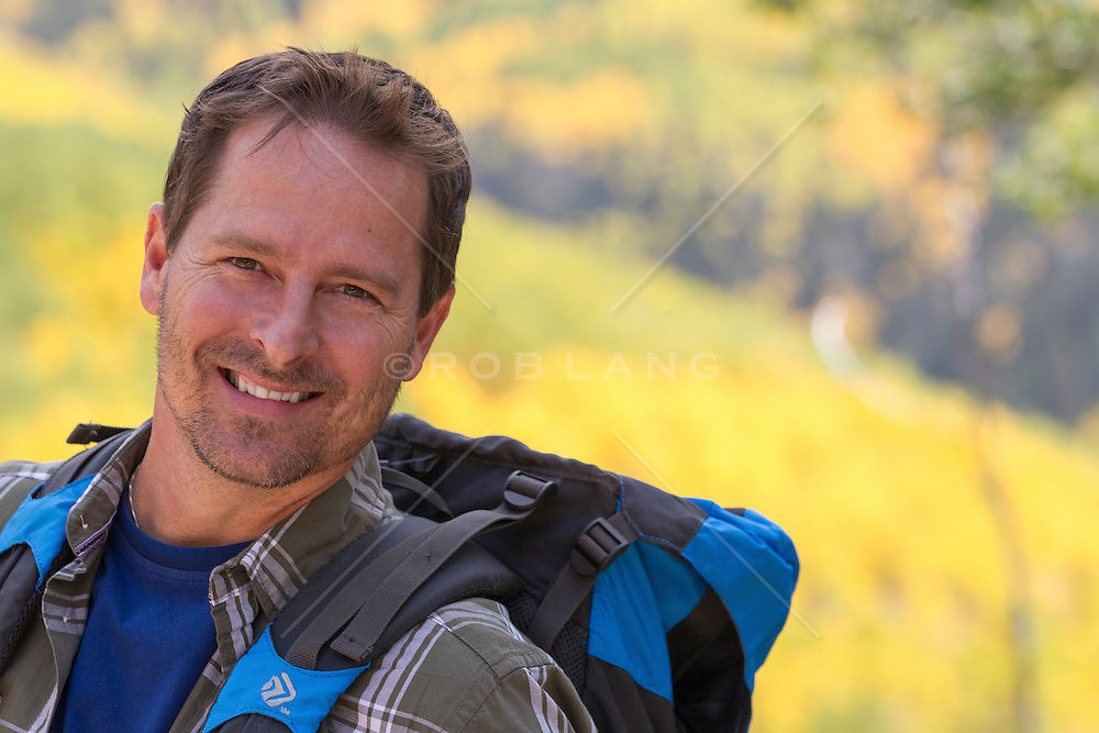 good looking middle aged man smiling while on a hike in the Santa Fe Mountains