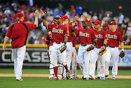 May 1 2011; Phoenix, AZ, USA; Arizona Diamondbacks outfielder Chris Young (24) , outfielder Justin Upton (10) , outfielder Gerardo Parra (8) are congratulated by teammates after defeating the Cubs 4-3 at Chase Field. Mandatory Credit: Jennifer Stewart-US PRESSWIRE.
