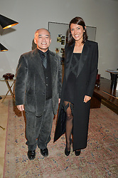 MASATO HAYASHI and HIKARI YOKOYAMA at a private view 'Urushi Lacquer - East Meets West' celebrating the ancient tradition of Japanese lacquer art held at the South Kensington Club Mews House, Queensberry Mews, London SW7 on 12th March 2015.