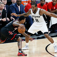 03 May 2017: San Antonio Spurs forward Kawhi Leonard (2) defends on Houston Rockets guard Lou Williams (12) during the San Antonio Spurs 121-96 victory over the Houston Rockets, in game 2 of the Western Conference Semi Finals, at the AT&T Center, San Antonio, Texas, USA.