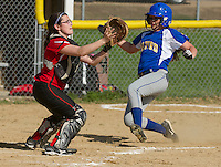A. Silva of Laconia makes the out at home ahead of Dean (3) of Gilford during NHIAA Division III Softball Wednesday afternoon.  (Karen Bobotas/for the Laconia Daily Sun)