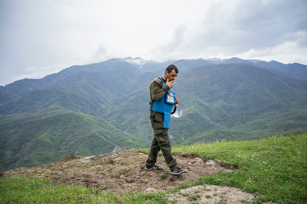 HAGOB KAMARI, NAGORNO-KARABAKH - APRIL 20: Erik Vardanyan, team leader of mine clearance team four for the charity HALO Trust, takes a break in an area that has already been cleared on April 20, 2015 in Hagob Kamari, Nagorno-Karabakh. Since signing a ceasefire in a war with Azerbaijan in 1994, Nagorno-Karabakh, officially part of Azerbaijan, has functioned as a self-declared independent republic and de facto part of Armenia, with hostilities along the line of contact between Nagorno-Karabakh and Azerbaijan occasionally flaring up and causing casualties. (Photo by Brendan Hoffman/Getty Images) *** Local Caption ***
