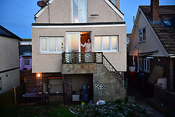 © Licensed to London News Pictures. 13/01/2017. Jaywick, UK.  A family look out from their home on the seafront at Jaywick before Homes are evacuated in Jaywick, Essex  due to the threat of flooding in low-lying areas . Photo credit: Ben Cawthra/LNP