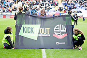 Banner against racism. EFL Sky Bet League 1 match between Bolton Wanderers and Rochdale at the University of  Bolton Stadium, Bolton, England on 19 October 2019.
