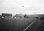 T J Kiernan, Cork Constitution, Irish full back, gets a high relieving kick, ..Irish Rugby Football Union, Ireland v New Zealand, Tour Match, Landsdowne Road, Dublin, Ireland, Saturday 7th December, 1963,.7.12.1963, 12.7.1963,..Referee- H Keenen, Rugby Football Union, ..Score- Ireland 5 - 6 New Zealand, ..Irish Team, ..T J Kiernan, Wearing number 15 Irish jersey, Full Back, Cork Constitution Rugby Football Club, Cork, Ireland,..J Fortune, Wearing number 14 Irish jersey, Right Wing, Clontarf Rugby Football Club, Dublin, Ireland,..P J Casey, Wearing number 13 Irish jersey, Right Centre, University College Dublin Rugby Football Club, Dublin, Ireland, ..J C Walsh,  Wearing number 12 Irish jersey, Left Centre, University college Cork Football Club, Cork, Ireland,..A T A Duggan, Wearing number 11 Irish jersey, Left Wing, Landsdowne Rugby Football Club, Dublin, Ireland,..M A English, Wearing number 10 Irish jersey, Stand Off, Landsdowne Rugby Football Club, Dublin, Ireland, ..J C Kelly, Wearing number 9 Irish jersey, Captain of the Irish team, Scrum Half, University College Dublin Rugby Football Club, Dublin, Ireland,..P J Dwyer, Wearing number 1 Irish jersey, Forward, University College Dublin Rugby Football Club, Dublin, Ireland, ..A R Dawson, Wearing number 2 Irish jersey, Forward, Wanderers Rugby Football Club, Dublin, Ireland, ..R J McLoughlin, Wearing number 3 Irish jersey, Forward, Gosforth Rugby Football Club, Newcastle, England, ..W J McBride, Wearing number 4 Irish jersey, Forward, Ballymena Rugby Football Club, Antrim, Northern Ireland,..W A Mulcahy, Wearing number 5 Irish jersey, Forward, Bective Rangers Rugby Football Club, Dublin, Ireland,  ..E P McGuire, Wearing number 6 Irish jersey, Forward, University college Galway Football Club, Galway, Ireland,  ..P J A O' Sullivan, Wearing  Number 8 Irish jersey, Forward, Galwegians Rugby Football Club, Galway, Ireland,..N A Murphy, Wearing number 7 Irish jersey, Forward, Cork Constitution Rugby Football Club, Cork, I