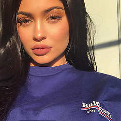 """Kylie Jenner releases a photo on Instagram with the following caption: """"morning \ud83d\udc99 wearing my new TWENTY Matte Lip from the #birthdaycollection available right now KylieCosmetics.com"""". Photo Credit: Instagram *** No USA Distribution *** For Editorial Use Only *** Not to be Published in Books or Photo Books ***  Please note: Fees charged by the agency are for the agency's services only, and do not, nor are they intended to, convey to the user any ownership of Copyright or License in the material. The agency does not claim any ownership including but not limited to Copyright or License in the attached material. By publishing this material you expressly agree to indemnify and to hold the agency and its directors, shareholders and employees harmless from any loss, claims, damages, demands, expenses (including legal fees), or any causes of action or allegation against the agency arising out of or connected in any way with publication of the material."""