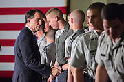Wisconsin Governor and GOP presidential candidate Scott Walker thanks cadets after he gave a foreign policy speech at the Citadel military college August 28, 2015 in Charleston, South Carolina. Walker criticized Hillary Clinton as unfit for the presidency because of her role in negotiating with Iran and her use of a private email system.
