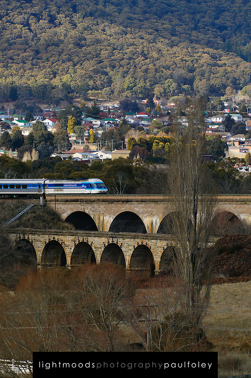 Countrylink Train crossing old stone bridge near Lithgow, NSW,Australia