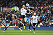 Derby County midfielder Tom Ince and Sheffield Wednesday striker Fernando Forestieri clash heads during the Sky Bet Championship match between Derby County and Sheffield Wednesday at the iPro Stadium, Derby, England on 23 April 2016. Photo by Jon Hobley.