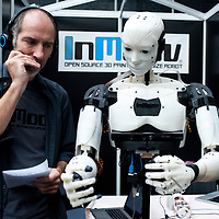 London, UK - 7 November 2013:  French sculptor and model-maker Gael Langevin, gives vocal commands to his InMoov Robot, an open-source humanoid robot comprised almost entirely of 3D printable parts at the 3D Printshow at the Business Design Centre in London.
