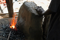 Ghana, Adaklu, Titikope, 2007. A boy helping provide power at the village blacksmith shop takes a moment to rest.