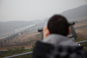 "Imjingak/South Korea, Republic Korea, KOR, 28.11.2009: Tourists watching at the  so called ""Bridge of Freedom"" at Imjingak, located 7 km from the Military Demarcation Line, which is now at the forefront of tourism related to the Korean Conflict. It was built in 1972 with the hope that someday unification would be possible."