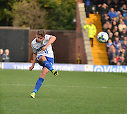 Bury Defender Joe Riley unleashes a free kick down the field during the Sky Bet League 1 match between Bury and Rochdale at Gigg Lane, Bury, England on 17 October 2015. Photo by Mark Pollitt.