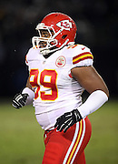 Kansas City Chiefs defensive tackle Vance Walker (99) jogs back to the sideline during the NFL week 12 regular season football game against the Oakland Raiders on Thursday, Nov. 20, 2014 in Oakland, Calif. The Raiders won their first game of the season 24-20. ©Paul Anthony Spinelli