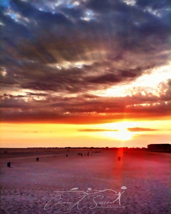 The sun sets on Dauphin Island beach in Dauphin Island, Alabama, July 6, 2012. (Photo by Carmen K. Sisson/Cloudybright)