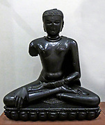 Buddha Shakyamuni (circa 1100-50) Basalt, Eastern India.  The historical Buddha was called  Shakyamuni' Sage of the Shakya clan.'  He abandoned his princely life to seek a way to escape the cycle of death and rebirth.  Here he is shown just before his enlightenment.
