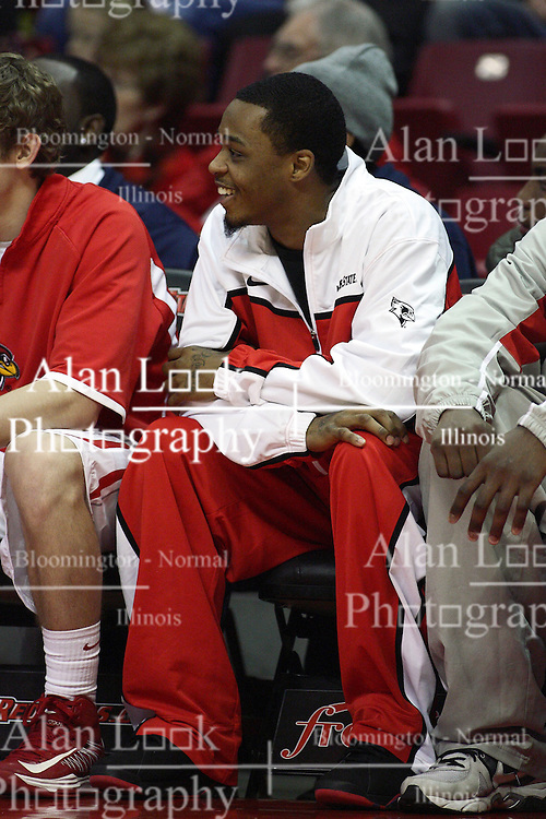12 January 2013:  Indefinitely suspended from play, Tyler Brown sits in sweats on the bench during an NCAA Missouri Valley Conference mens basketball game Where the Bulldogs of Drake University beat the Illinois State Redbirds 82-77 in Redbird Arena, Normal IL