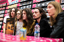 """© Licensed to London News Pictures . 05/08/2016 . Manchester , UK . Stockport five piece , Blossoms , perform a live gig and sign copies of their first album , """" Blossoms """" , for fans at HMV in the Arndale Centre , Manchester City Centre . Photo credit : Joel Goodman/LNP"""