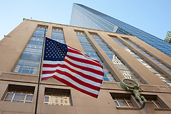 Buildings in NYC with American Flag in Foreground
