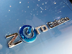 Close up of Zero Emission logo on Nissan electric car at the Geneva Motor Show 2011